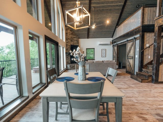 A beautiful dining area with a view across the Ponca Wilderness awaits you at the Wildwood Cabin.