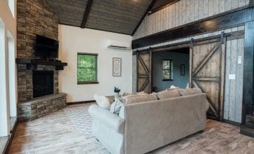 The Wanderlust Cabin's beautiful living area with gas log fireplace is the perfect place for a romantic getaway.