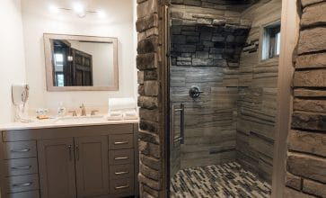 The Wildwood Cabin features a unique bathroom with waterfall shower.