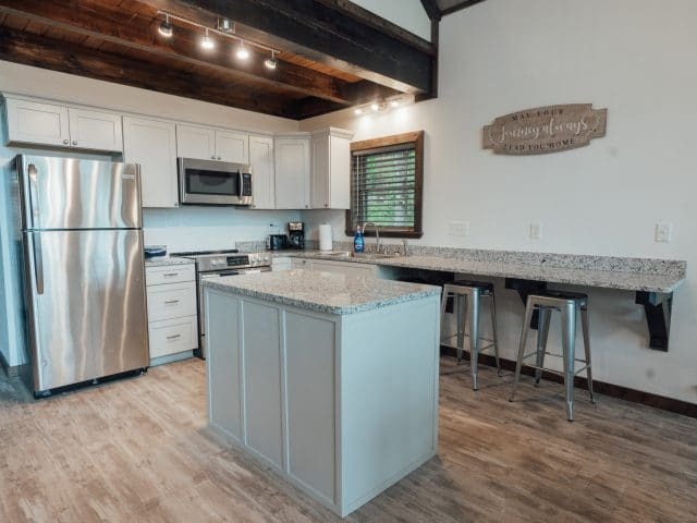 Enjoy a spacious kitchen with full-size appliances in the Foxfire Cabin.