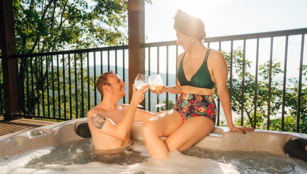Couple in hot tub at Buffalo Outdoor Center cabin.