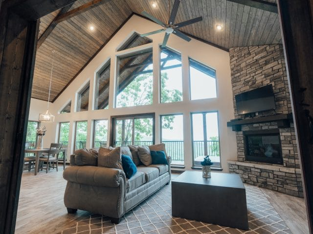 The Foxfire Cabin's vaulted ceiling and elegant, spacious living room are perfect for a family vacation, gathering of friends or romantic getaway,.