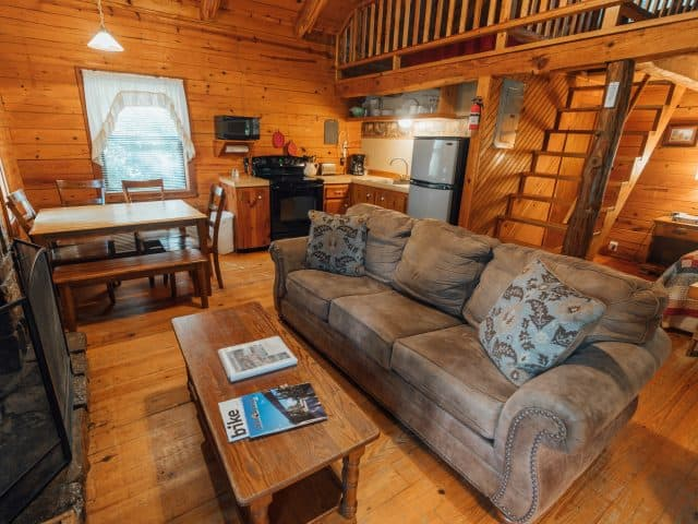 Relax in the cozy comfort of Cabin 4's living area after a full day of outdoor adventure.