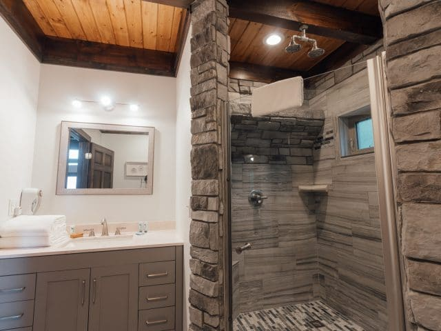 Treat yourself to a waterfall shower in the Foxfire Cabin's beautiful showerbath.
