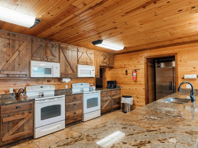 The kitchen of RiverWind Lodge features a commercial-size fridge, double ovens, microwaves and dishwashers.