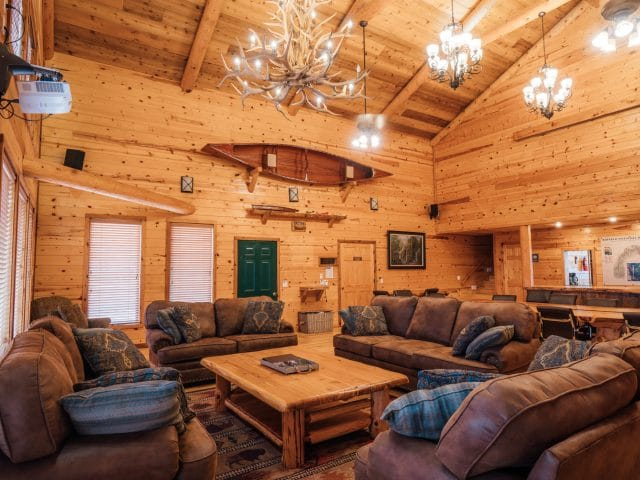 The RiverWind Lodge Great Room with its appointments of rustic elegance and a view across Arkansas's prettiest place.