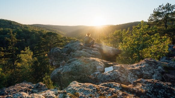 A hiker taking in the view from Pedestal Rocks Scenic Area