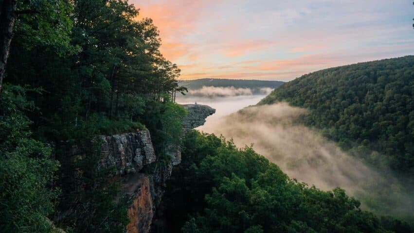 A colorful sunrise and fog at Whitaker Point / Hawksbill Crag.