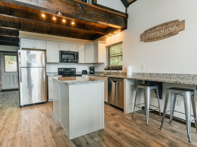 The chef in you will enjoy the spacious countertops and full appliances of the Wanderlust Cabin.