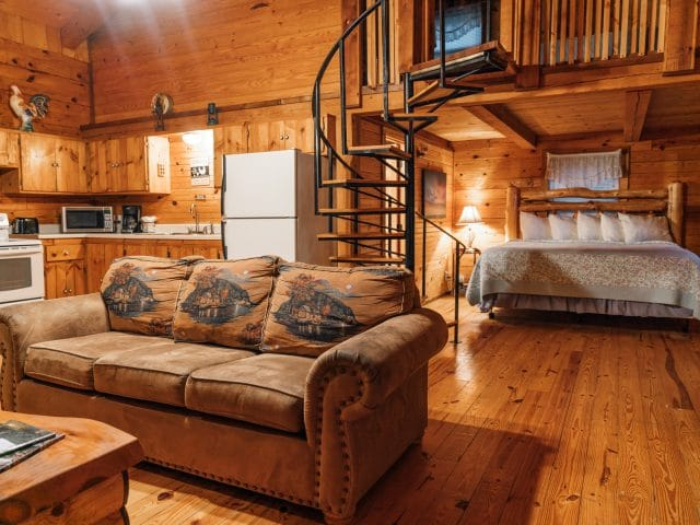 The main floor of the Mountain Magic Cabin features a spacious setting for relaxation with family, friends or just two!