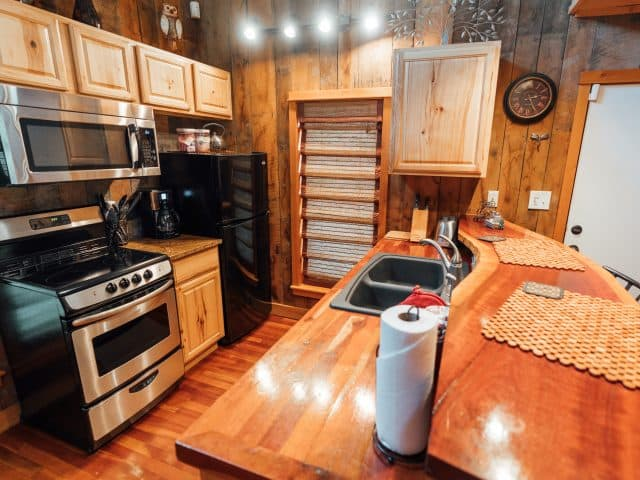 You'll enjoy a fully-appointed kitchen in the Creekside Cabin.