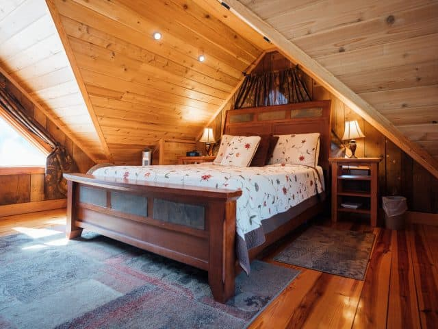 The cabin's loft is furnished with a comfortable queen-size bed.