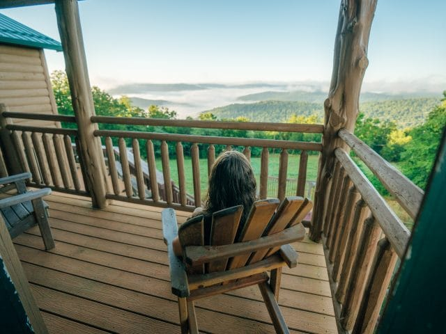 A woman takes in the view from one of the Riverwind Lodge balcony's.