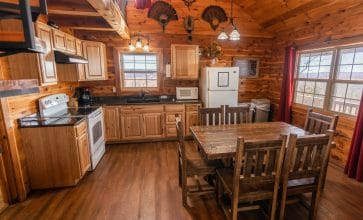 Enjoy preparing meals in the Waterfall Cabin's fully-furnished kitchen.