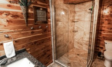 The Waterfall Cabin features a beautifully rustic showerbath.