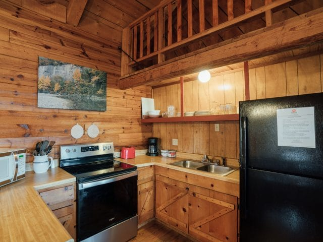 The Buffalo River Cabin features a fully-appointed kitchen.
