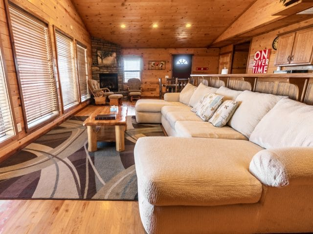 Relax in spacious comfort in the living and dining area of the Mountain Sunset Cabin, complete with romantic gas fireplace.
