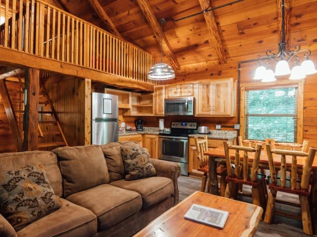 Cabin 2 features a comfy living and dining area, sleeping loft and woodburning fireplace.