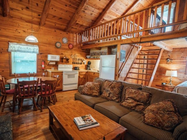 The Songbird Cabin features an open floor plan and upstairs sleeping loft, which is perfect for families.