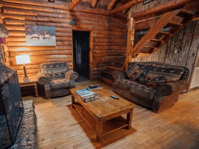 The Mills Cabin is a terrific basecamp for adventure with family or friends, with its large living area with woodburning fireplace.