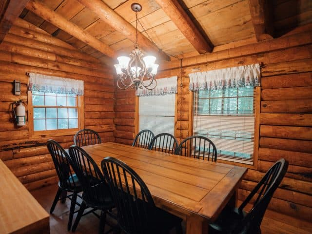 The dining area of the Mills Cabin easily hosts your family or friends for hearty meals.
