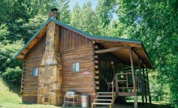 The Songbird Cabin in its tucked-away location is the perfect place for porch time in Ponca.