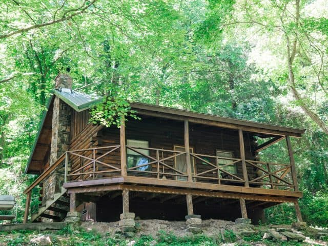At Cabin 4, you can relax in the porch swing while the kids romp in the yard!