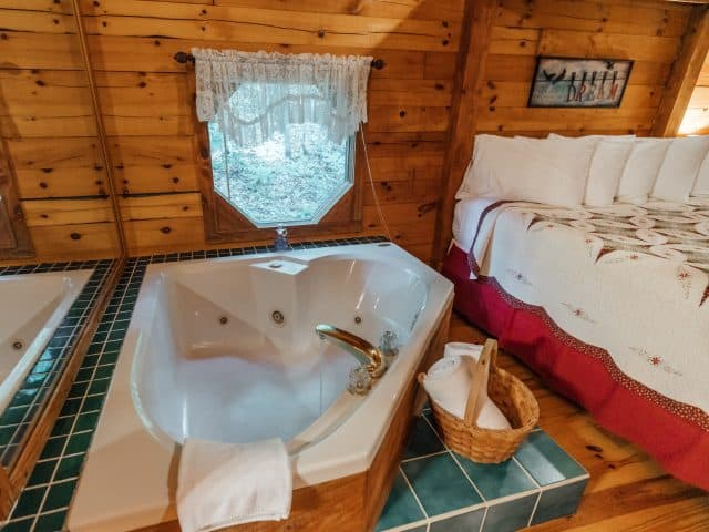 The Valley Dream Cabin has a romantic bedside jacuzzi tub for two.
