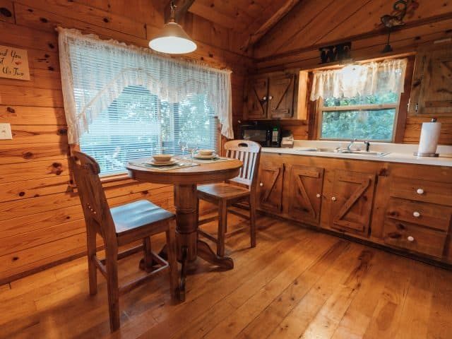 Serve a romantic dinner for two in the Mountain Ecstasy's fully furnished kitchen and dining area.