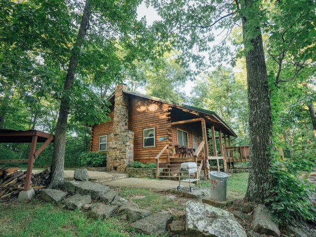 Treat yourself to a magical Buffalo River getaway at the Mountain Magic Cabin, complete with outdoor hot tub deck.