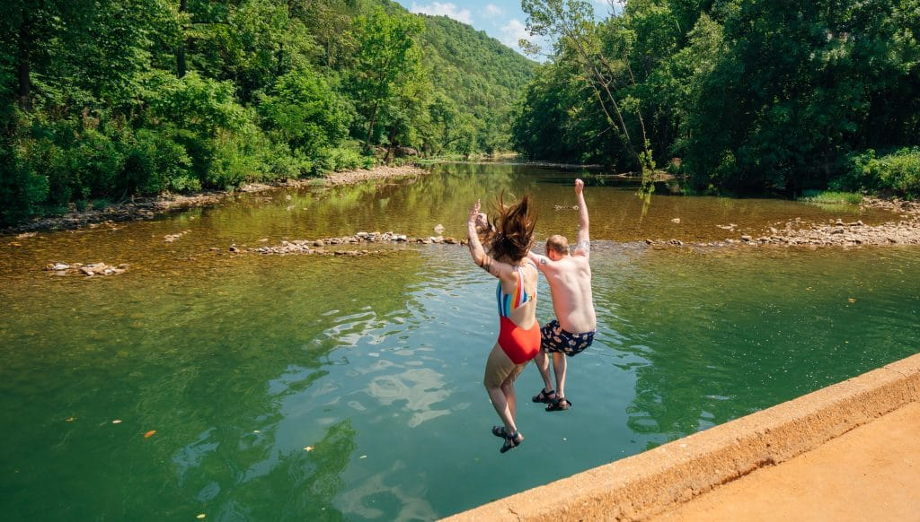 Couple Jumping into Buffalo River