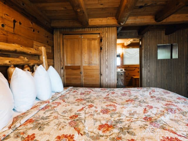 The master bedroom with adjacent private showerbath in the Arkansas Cabin.
