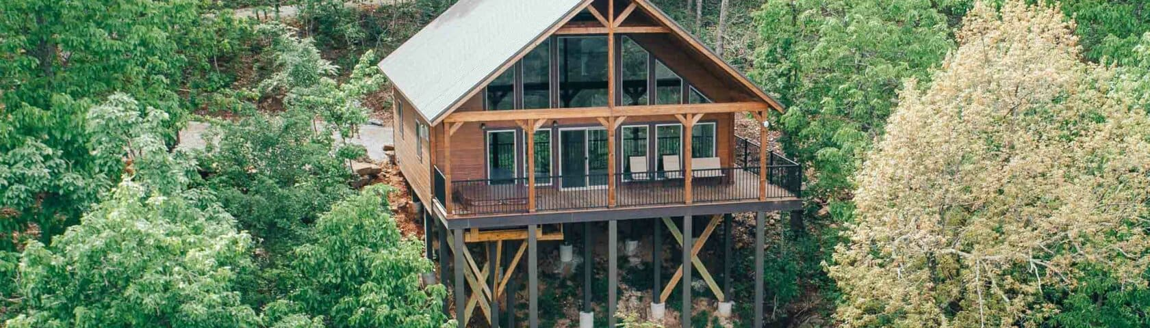 aerial view of a cabin in the woods