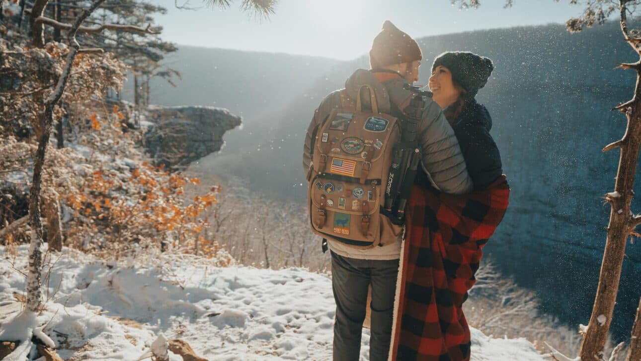 couple hugging on a hike in the winter