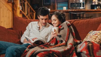 couple reading in a cabin