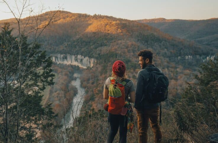 two adults hiking in the winter