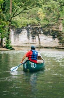 A canoeist floating Ponca to Kyles Landing.