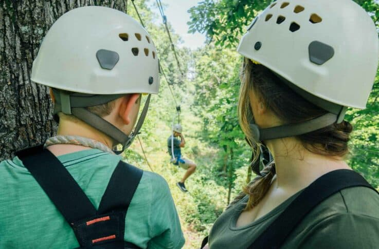 A mom and son watching a zipper on the Buffalo River Canopy Tour.