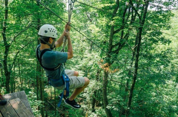 A teenager zipping along the Buffalo River Canopy Tour.