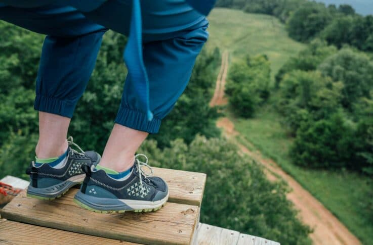 A view of feet before zipping on the Buffalo River Canopy Tour.