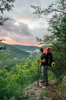 A Hiker on the Buffalo River Trail at Sunset.