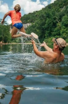 A dad and daughter playing in the Buffalo River together.