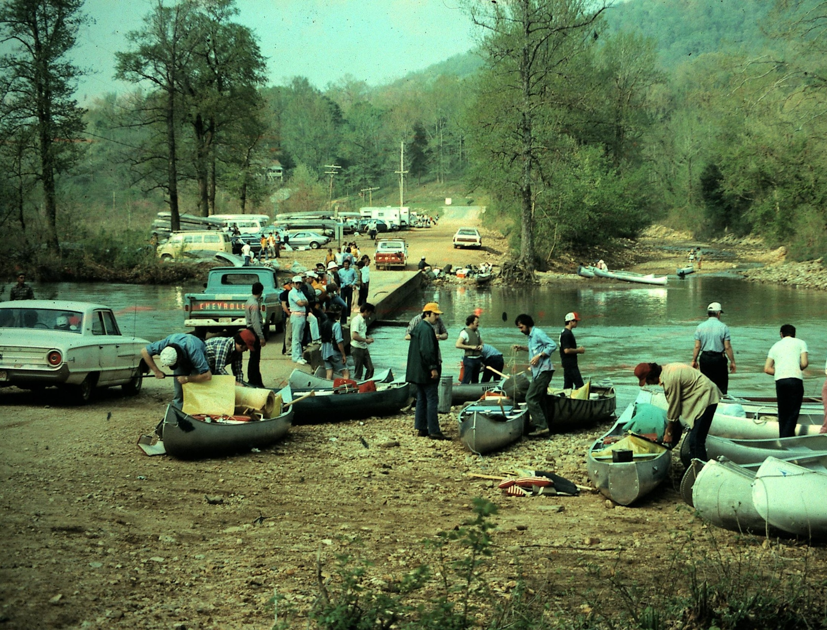 Vintage image from 70's of people putting on canoes at the Ponca Access.