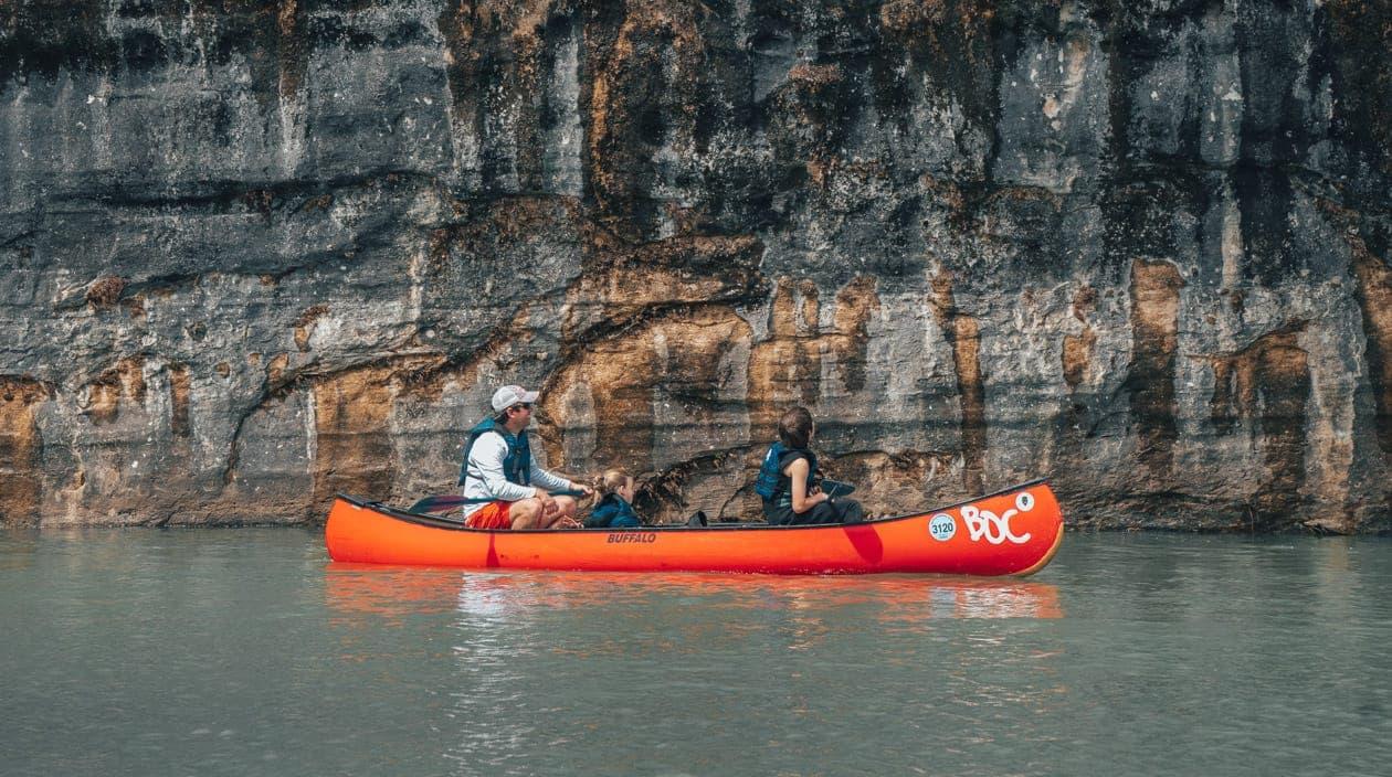 canoe by rock cliff