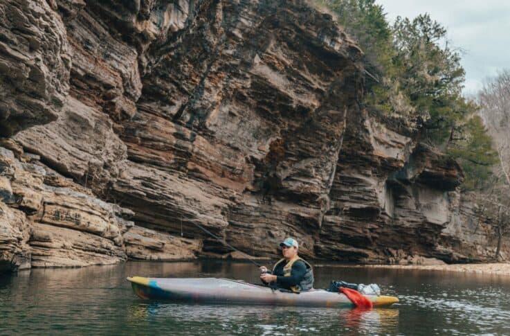 Man fishing from a kayak on Pruitt