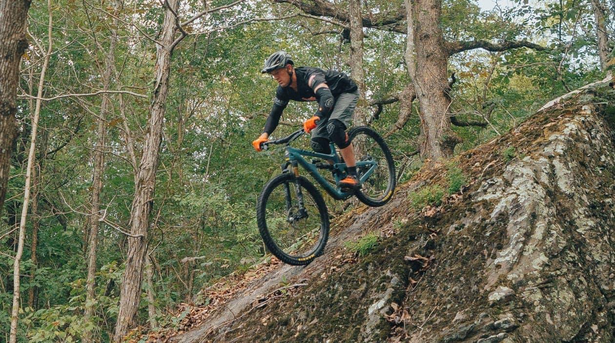 biking down a steep trail