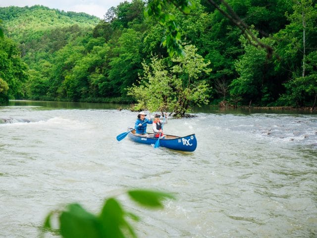 Couple canoeing on the Buffalo National River at Steel Creek.
