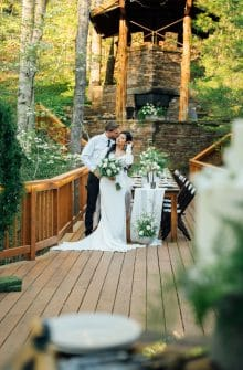 A couple posing together at their wedding at the Ponca Creek Lodge.