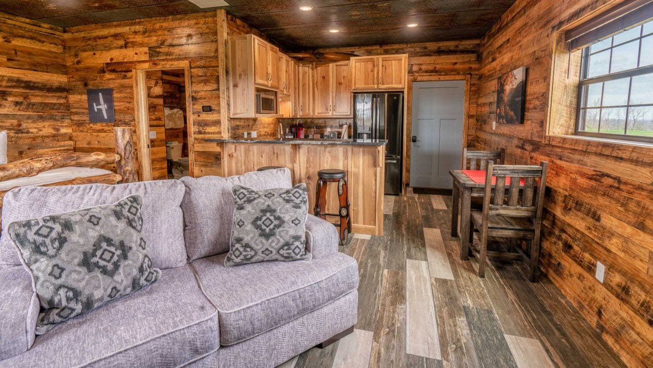 couch and kitchen in the fly in lodge