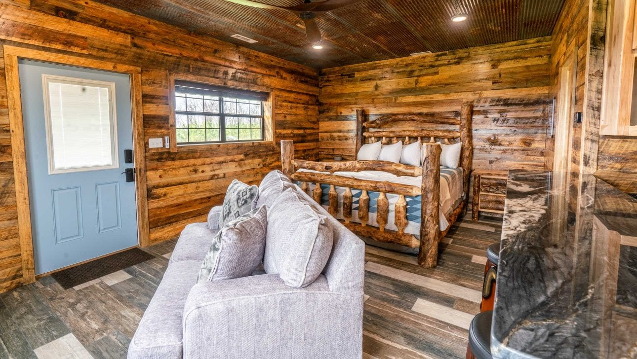 couch and bed in the fly in lodge